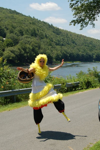 Digital photo photograph of NACL Theatre actress and artistic director Tannia Kowalchuk performs a stilt walking dance in Barryville, NY near the Upper Delaware River.