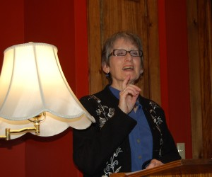 Self-published author Marcia Nehemiah reads at the launch party for her new book Crone Age.