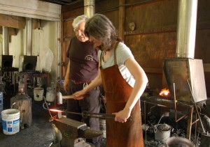 Is this sustainability? Hammer, anvil photo of blacksmithing a driving hook at Peters Valley School of Craft at Delaware Water Gap National Recreation Area.