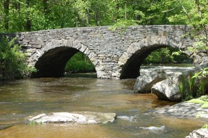 Photo of the Stone Arch Bridge at Ten Mile River along the Upper Delaware River near the Tusten Mountain hiking trail. Visit it on National Trails Day.
