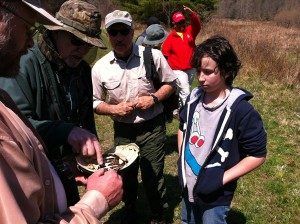 Digital photograph of volunteers examining the remains of a snapping turtle found on the site where the first Upper Delaware BioBlitz will be held on June 29, 2013.