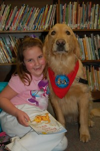 Photo of Davalyn Ursich of Honesdale, PA and her canine tutor, Sherman. Part of a program where kids read to dogs.