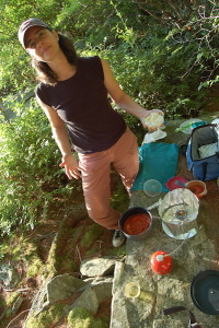 Photo by Sandy Long of Heron's Eye Communications Co-Founder Krista Gromalski making trail pizza with MSR gear.